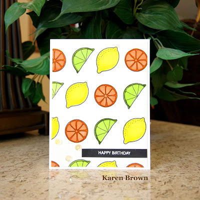 Handmade card featuring lemons, limes and oranges.