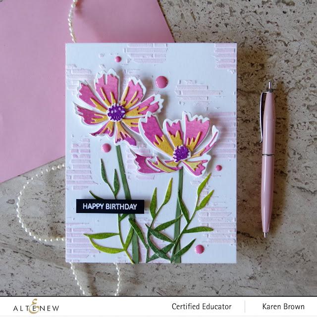 Die-cut watercolored pink flowers