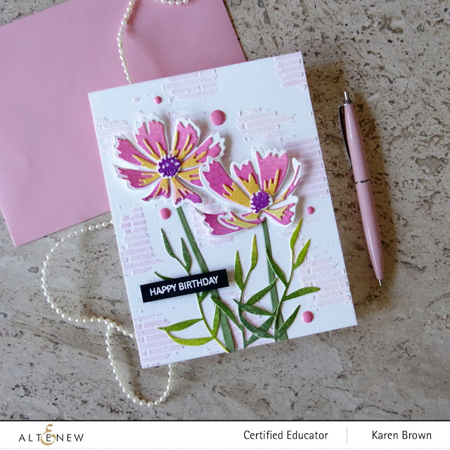 Pink die-cut flowers with mixed media background