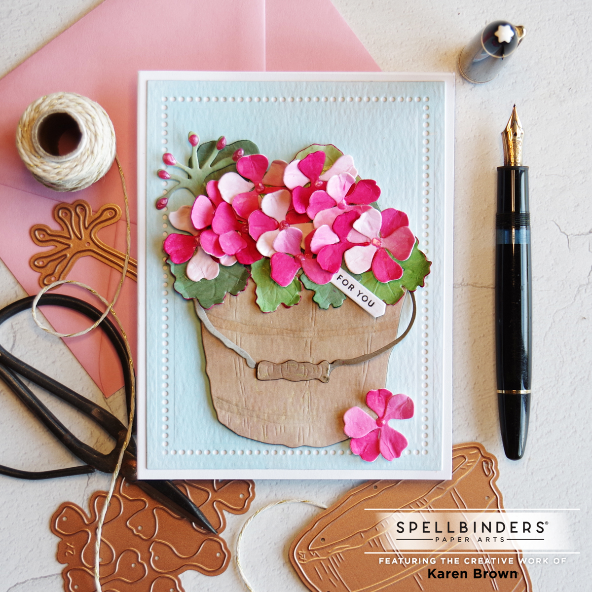 Die Cut Geranium card with hand crafted papers.